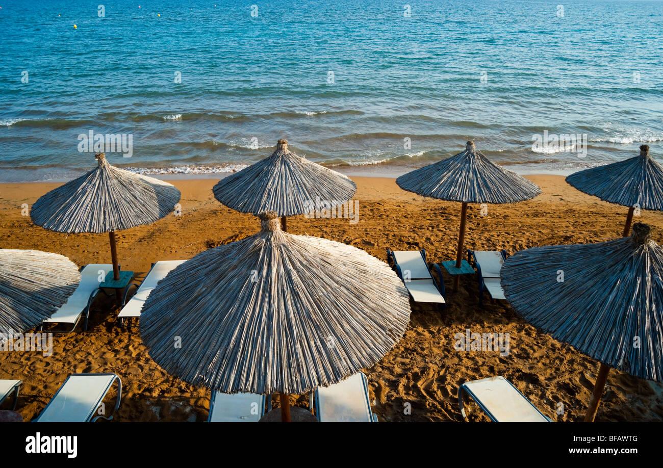Xi beach near Lixouri on the Pali peninsular of Kefalonia - sun shades and red sand - Stock Image