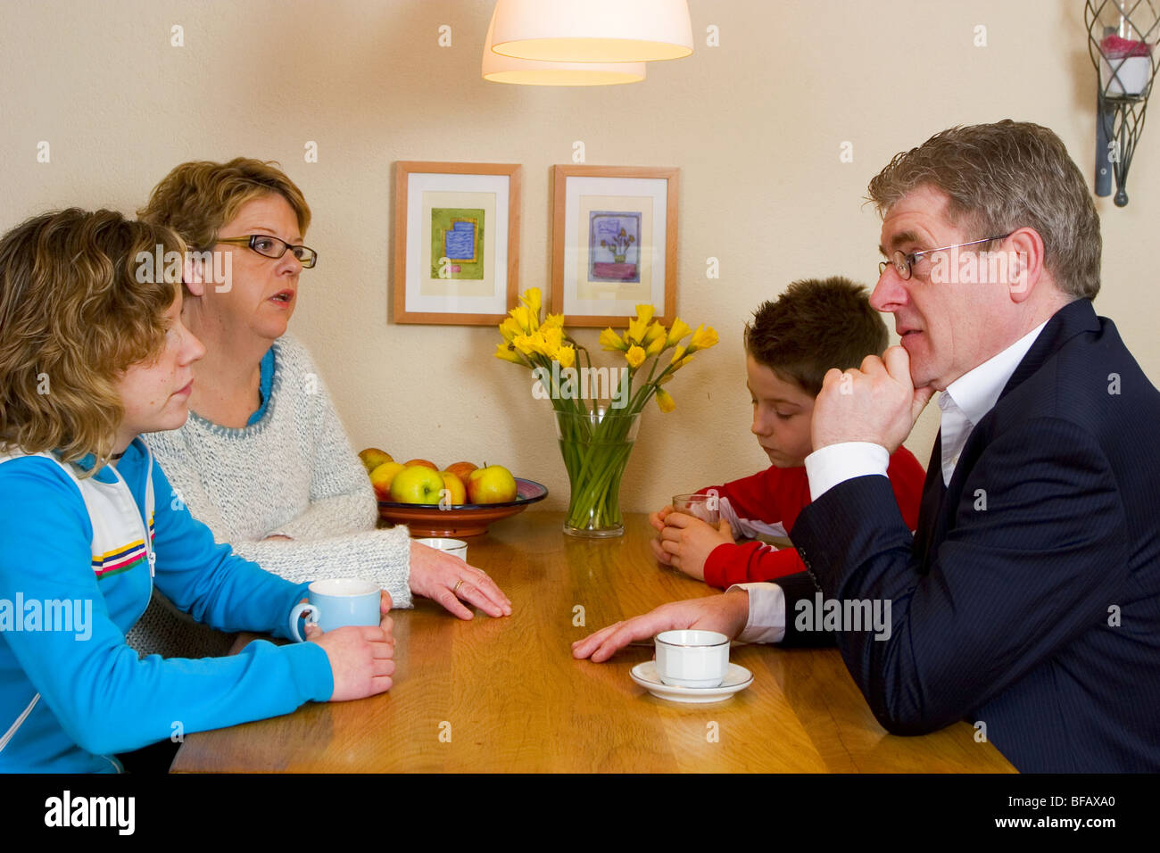 Family tension - Family talking at table - Stock Image