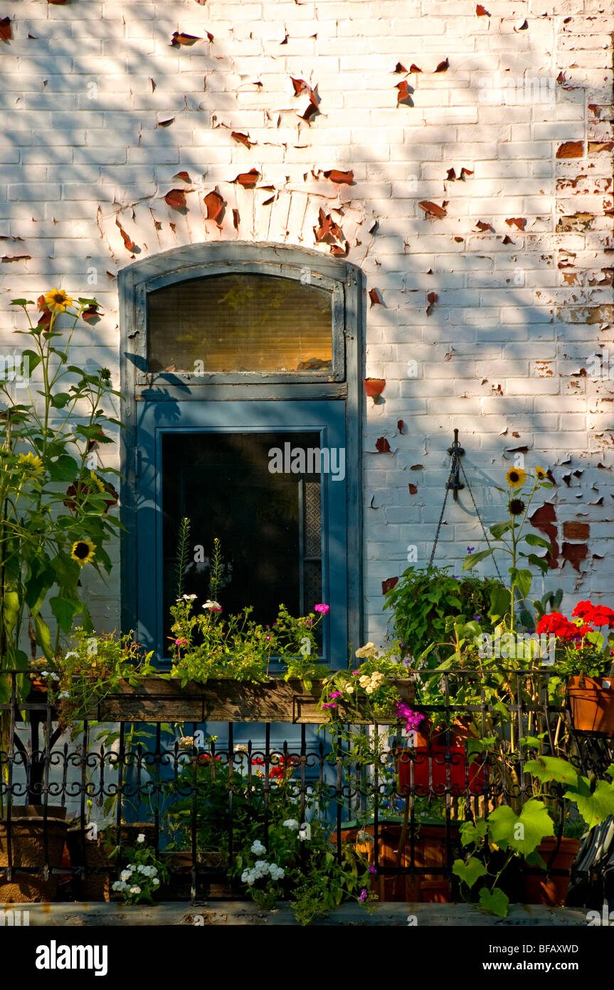 Balcony of a house with flowers - Stock Image