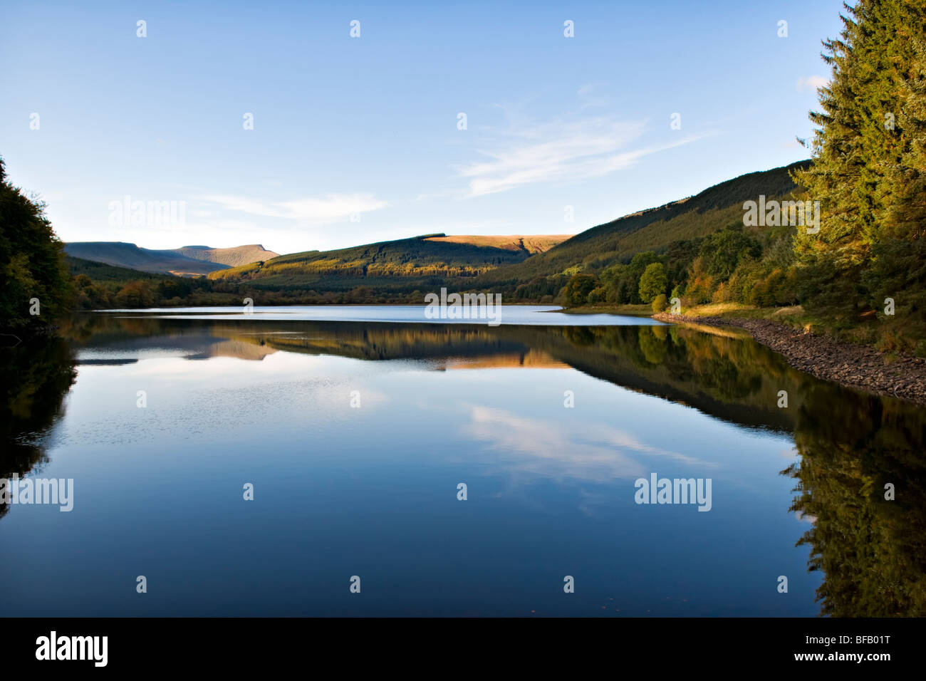 Pentwyn Reservoir (known locally as Dolygaer Lake) in the Brecon Beacons Mid-Wales early evening with reflection Stock Photo