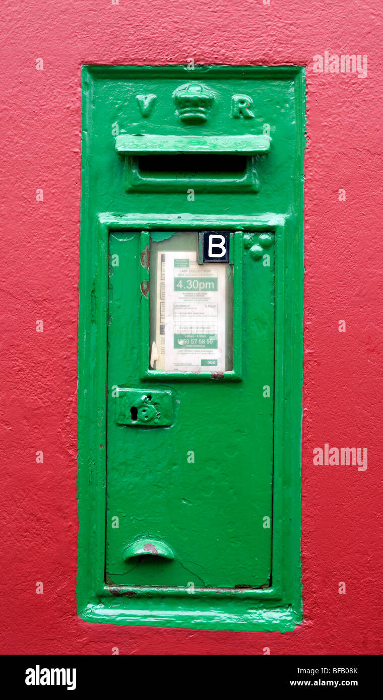 Green Victorian Post Box set in wall, Southern Ireland, Eire. - Stock Image