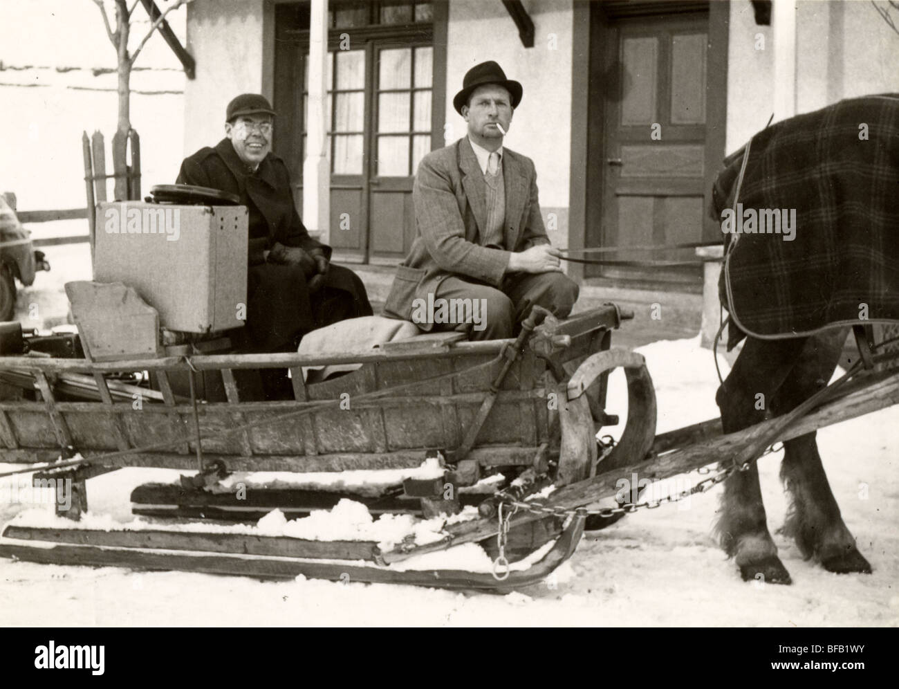 Man Driving Hotel Guest in Horse Drawn Sleigh Stock Photo