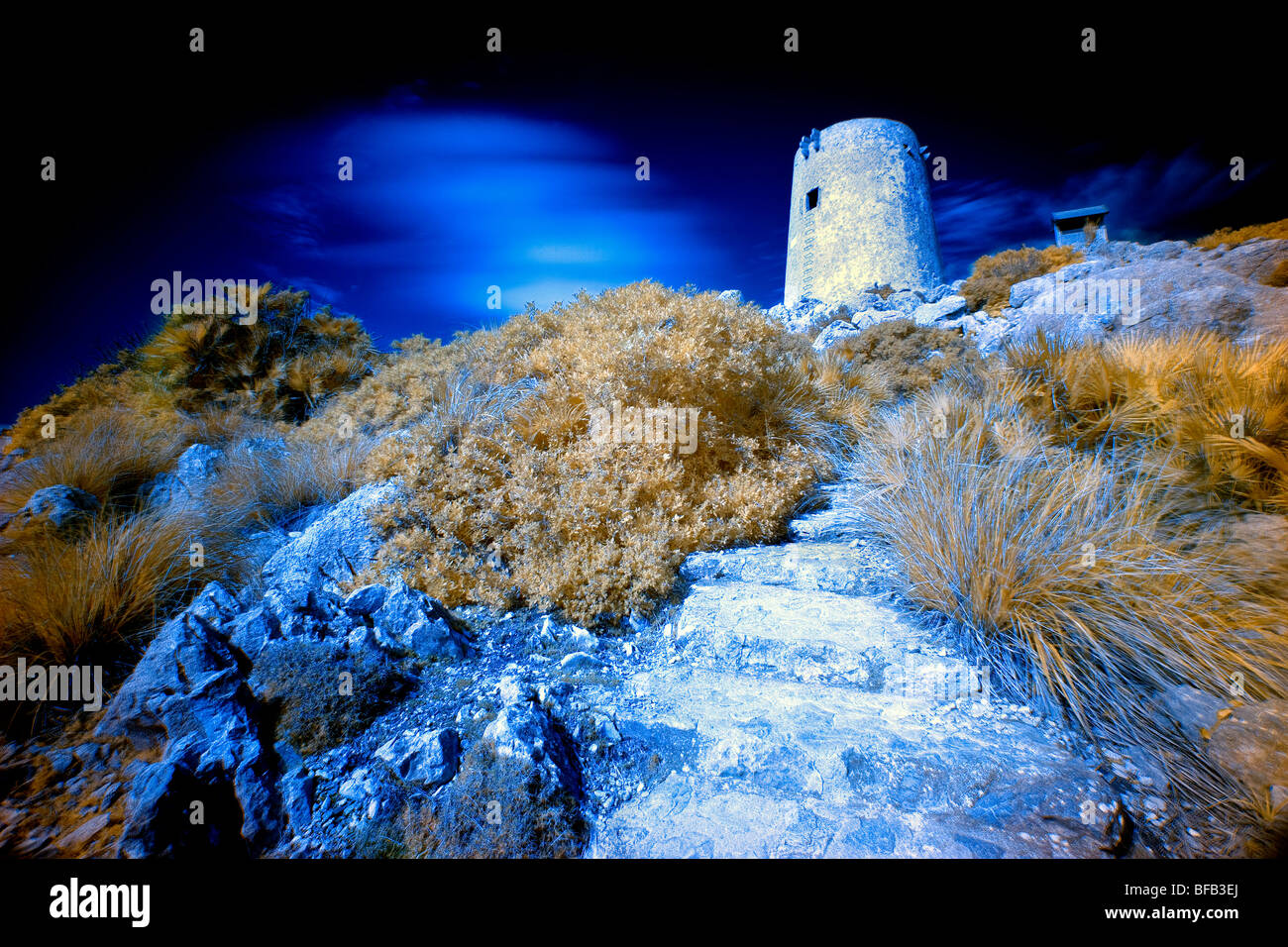 Pirate watchtower, Cap Formentor, Mallorca, infra-red. - Stock Image