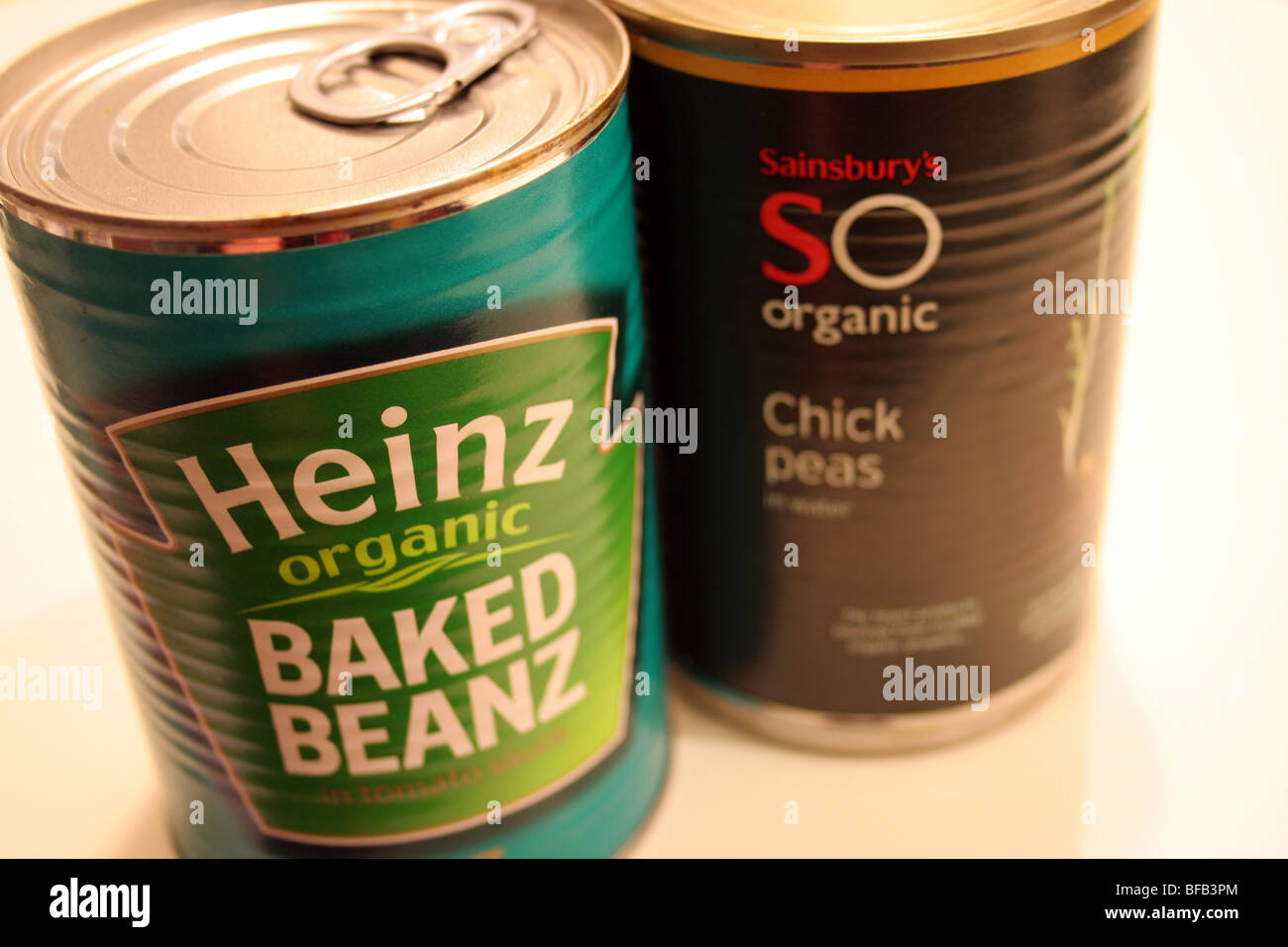 Organic tinned food - baked beans and chick peas - Stock Image
