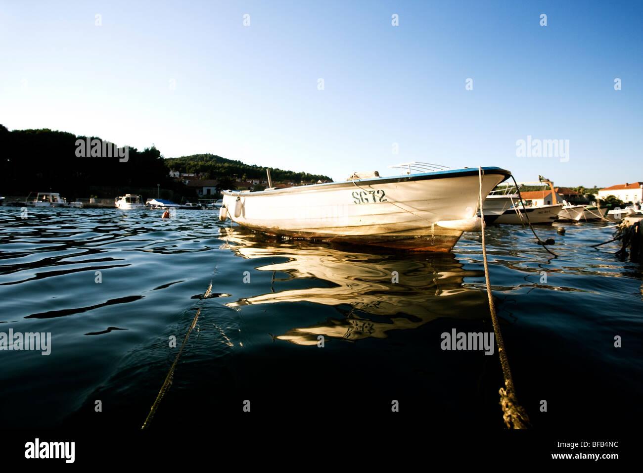 Rowing boat tied up, Stari Grad, Hvar Island, Croatia - Stock Image