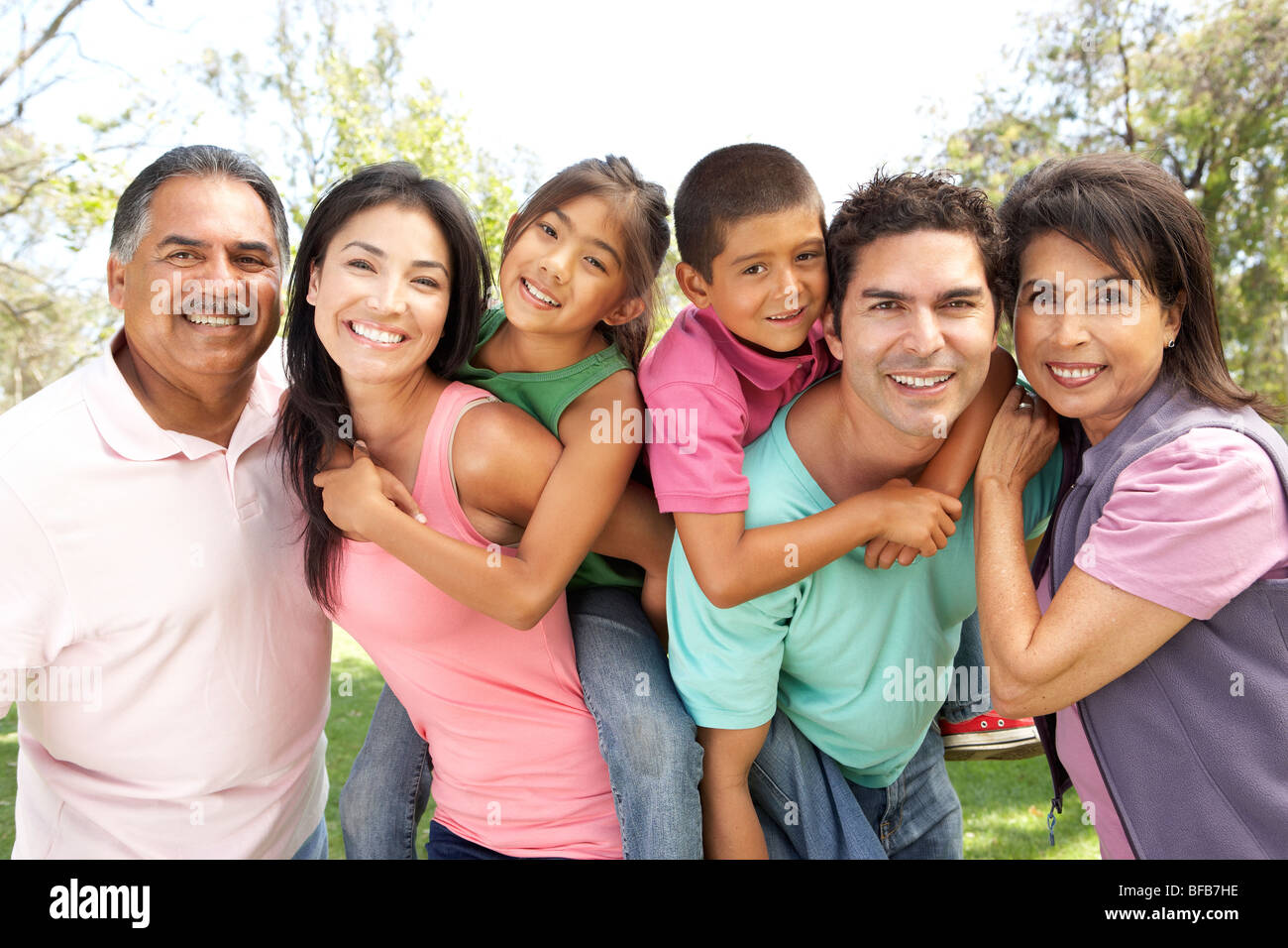 Extended Family Group In Park - Stock Image