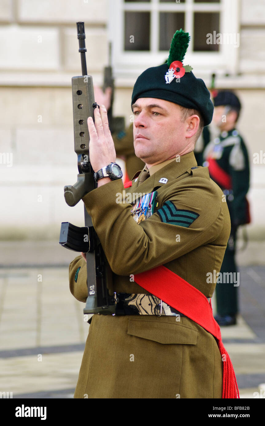 Soldier from the Royal Irish Regiment presenting arms during Remembrance Sunday service - Stock Image