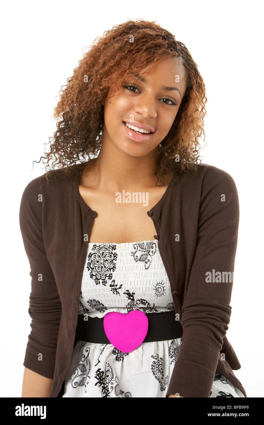 Studio Portrait Of Happy Teenage Girl - Stock Image