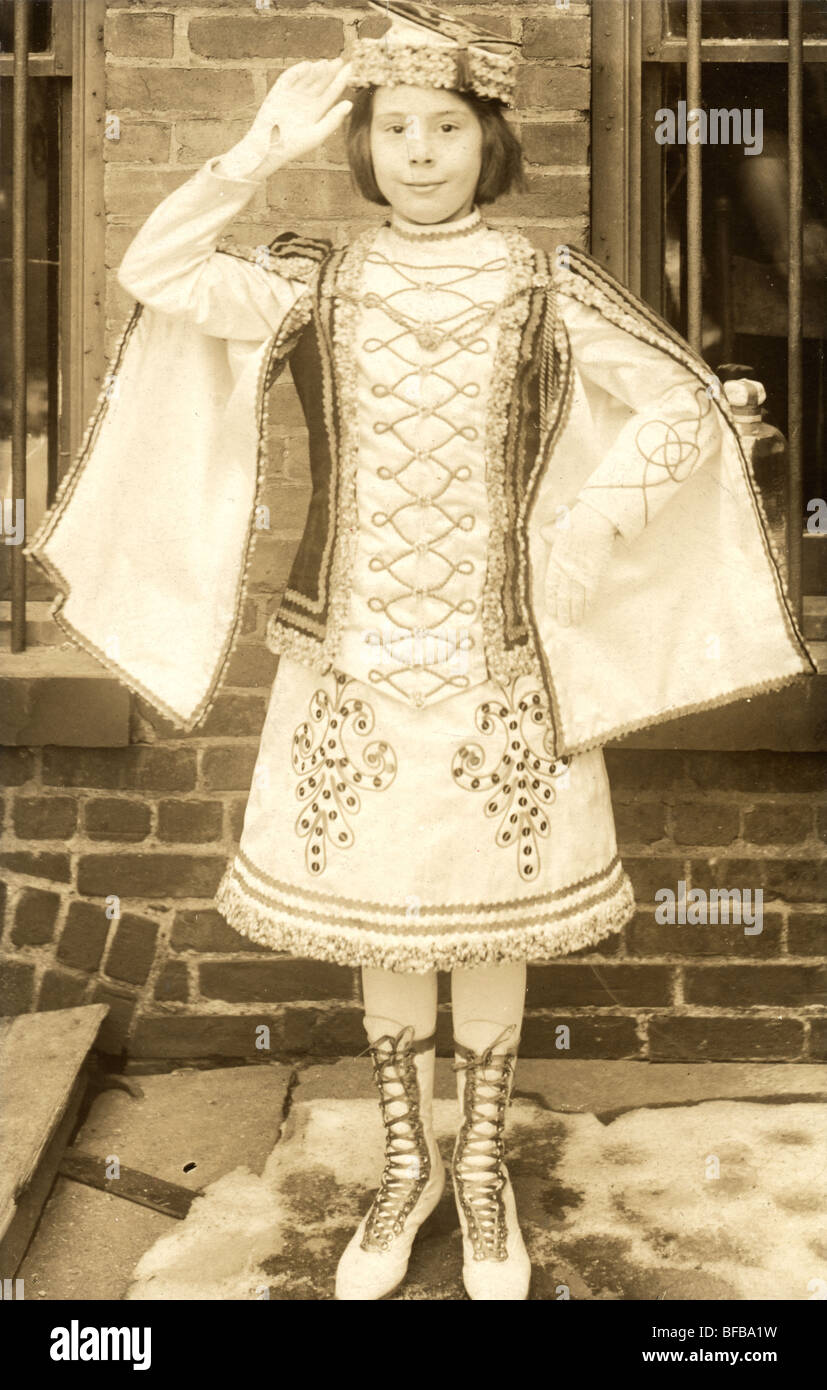 Girl in Elaborate Marching Costume Saluting - Stock Image