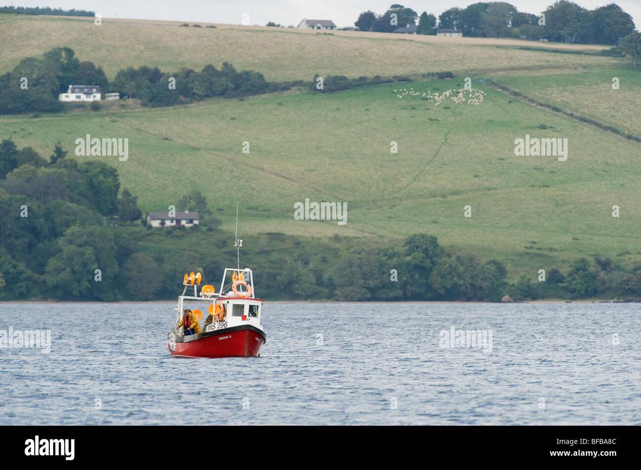 Small fishing boat, Moray Firth, Scotland. Stock Photo