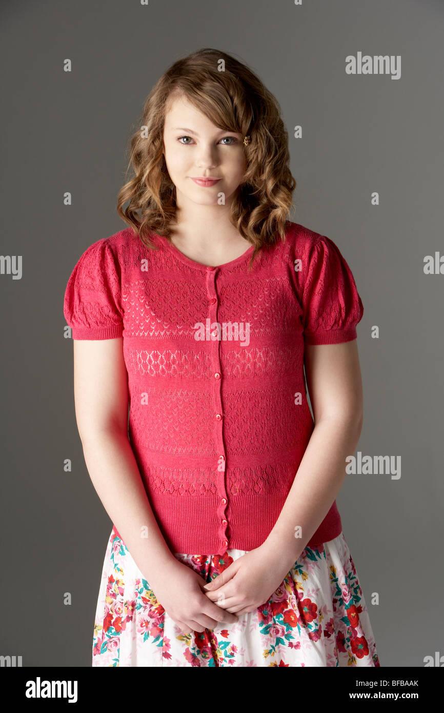 Studio Portrait Of Fashionably Dressed Teenage Girl - Stock Image