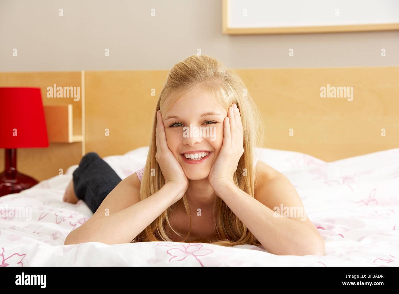 Portrait Of Teenage Girl In Bedroom - Stock Image