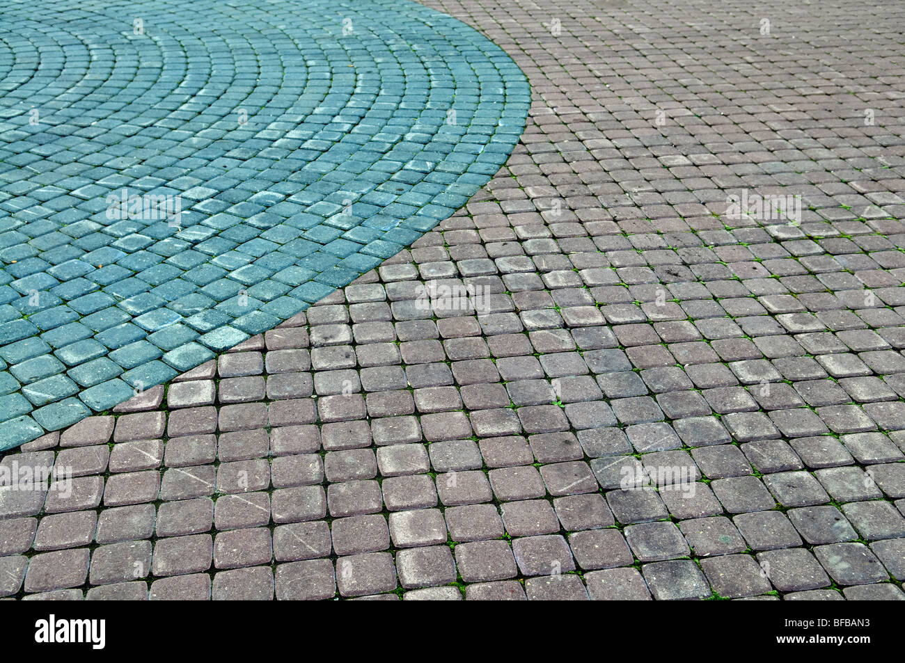 Color cobblestone pavement useful for background - Stock Image