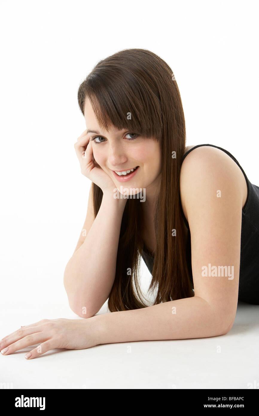 Studio Portrait Of Teenage Girl On White Background - Stock Image
