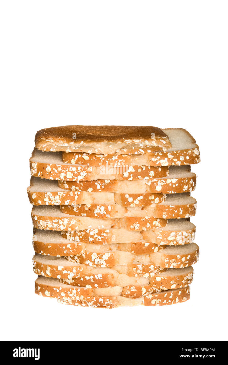 A stacked loaf of sliced wholegrain oat bread isolated on white. Stock Photo