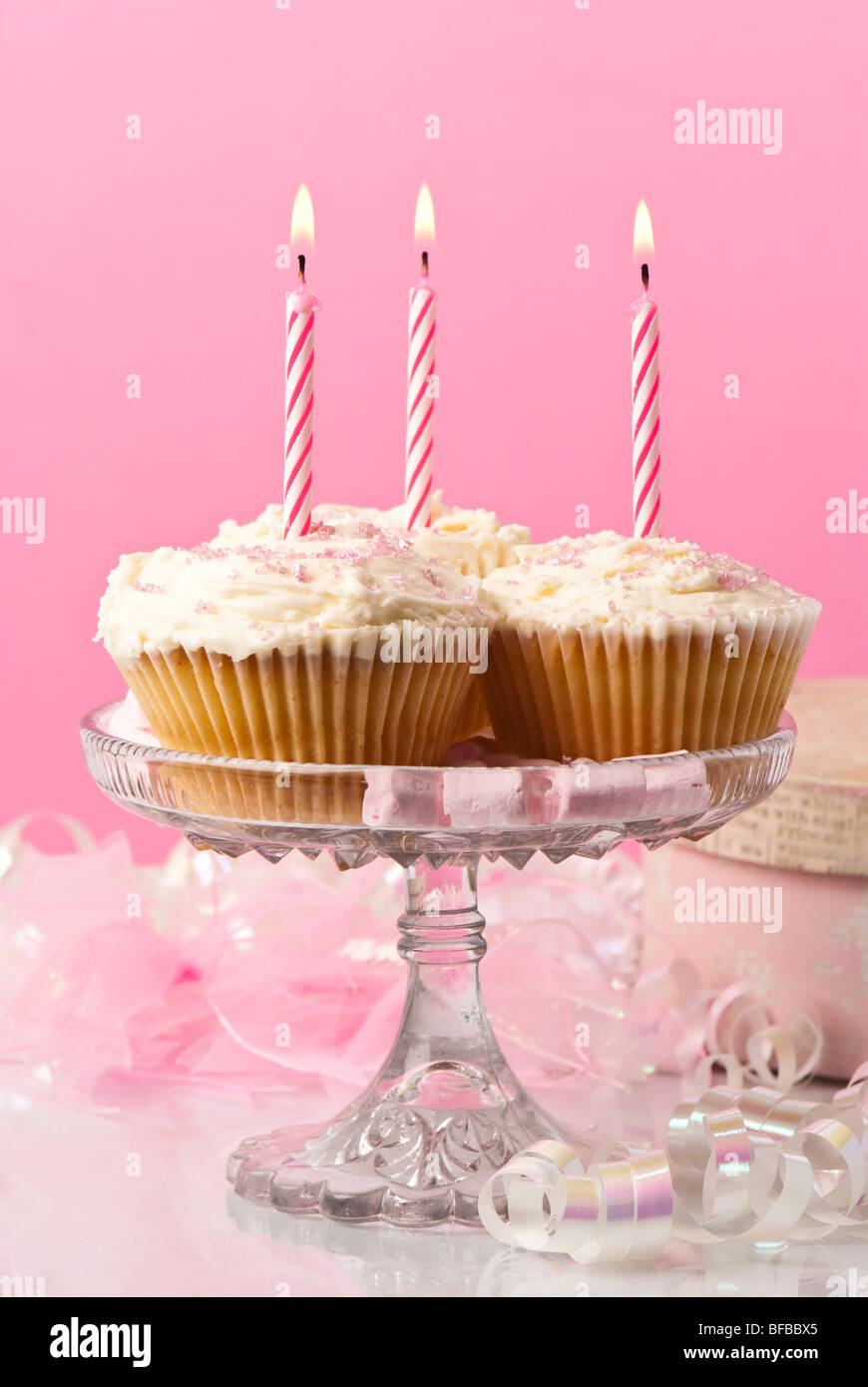Birthday cupcakes with candles - pink theme - Stock Image