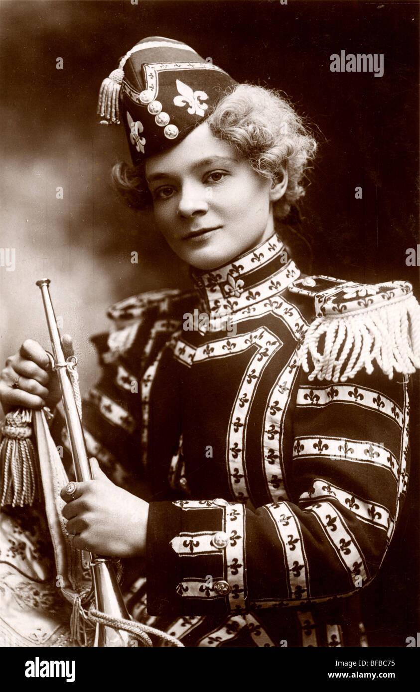 Beautiful Woman Band Member with Bugle - Stock Image