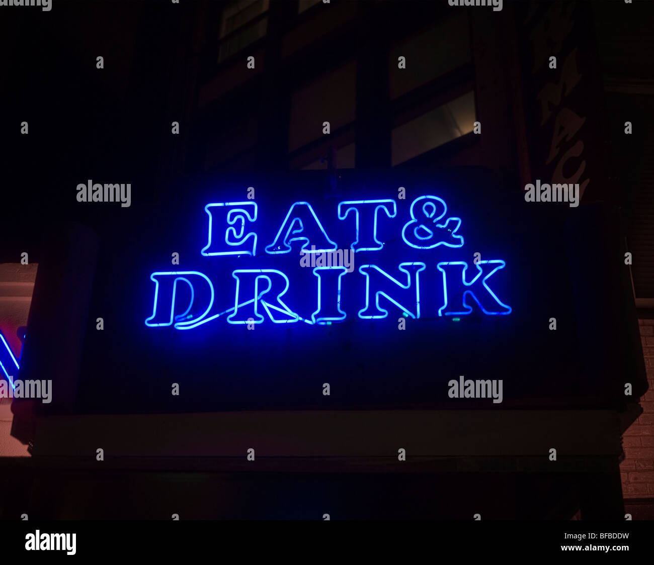 Eat and drink illuminated neon sign at the entrance of a