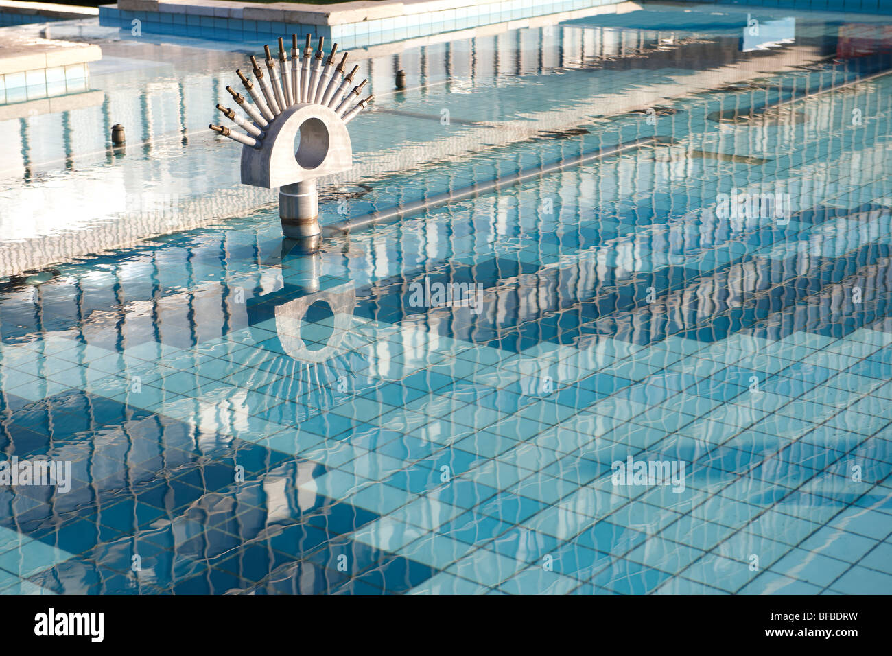 Urban textures - reflections in water with blue tiles - Stock Image