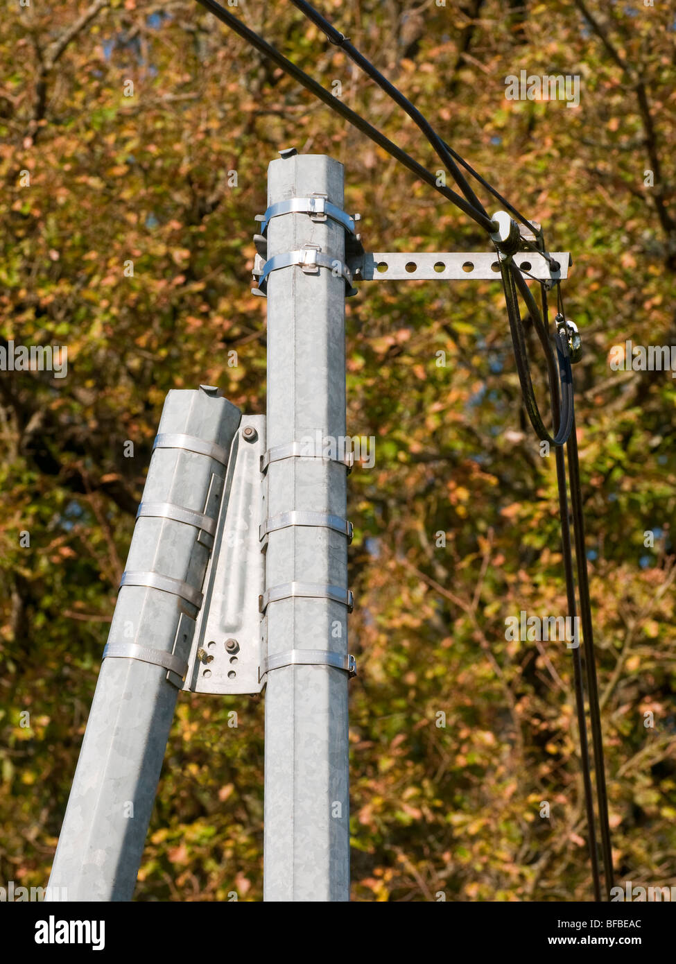 New galvanized metal telephone pole - France. - Stock Image