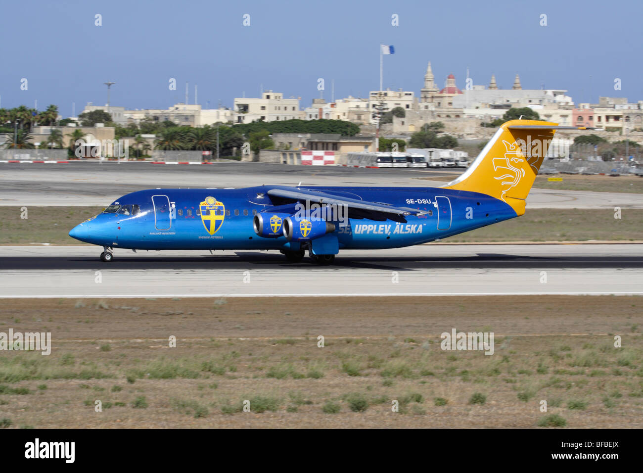 Malmo Aviation Avro RJ100 in special colours departing from Malta - Stock Image