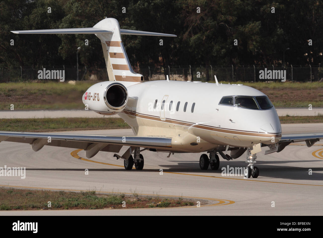 Bombardier Challenger 300 business jet taxiing on arrival at Malta International Airport - Stock Image