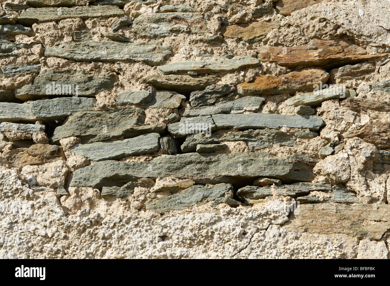 Urban textures - medieval stone wall - Stock Image