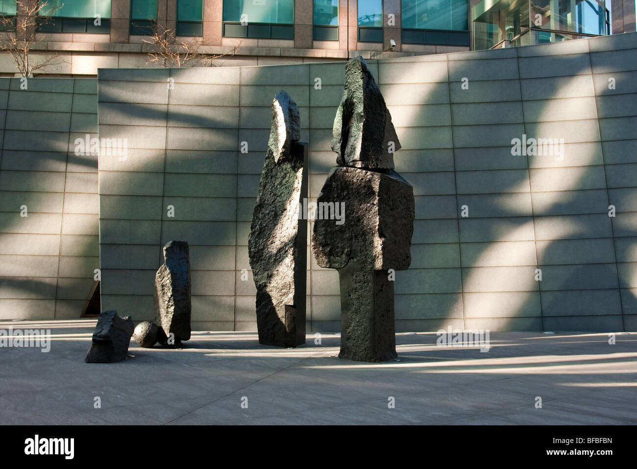 Sculpted in basalt by Xavier Corbero is The Broad Family, situated at Broadgate office complex in the City of London. - Stock Image