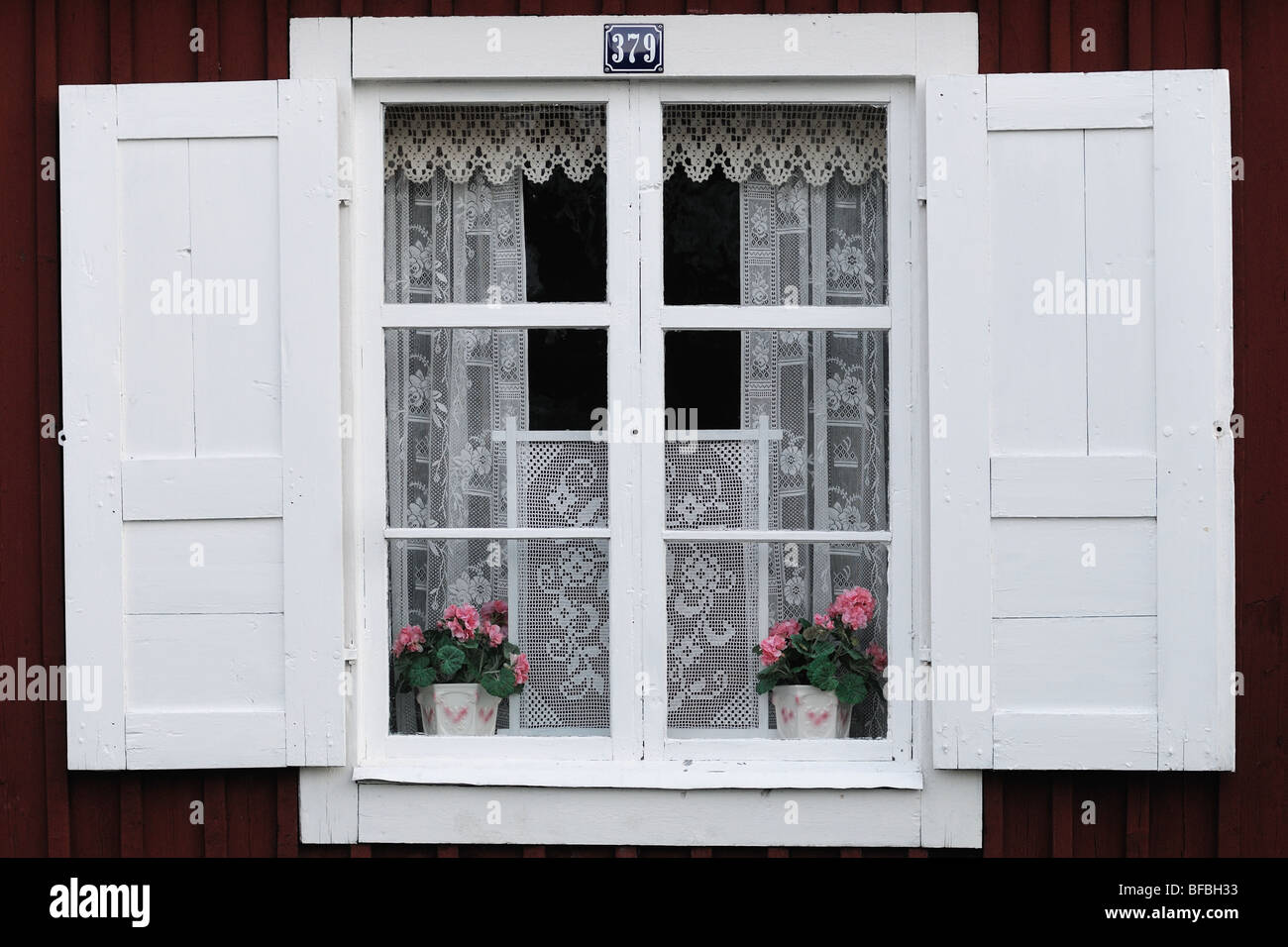 A typical old fashioned swedish window decorated with white curtains a typical old fashioned swedish window decorated with white curtains and two pots with flowers it has two white shutters mightylinksfo