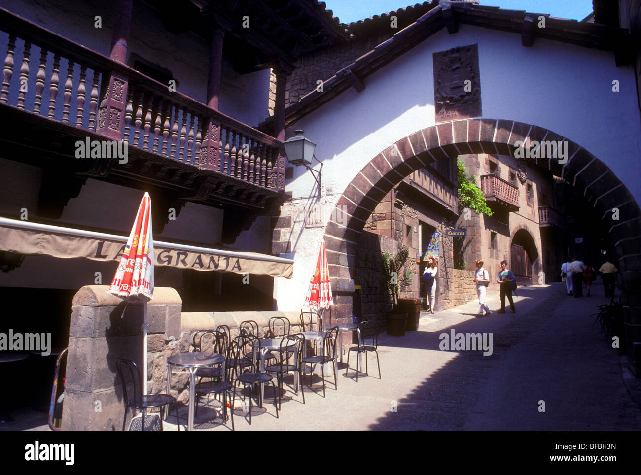 Tourists by a café in the 'Pueblo Espanol'  the Spanish village in Barcelona - Stock Image