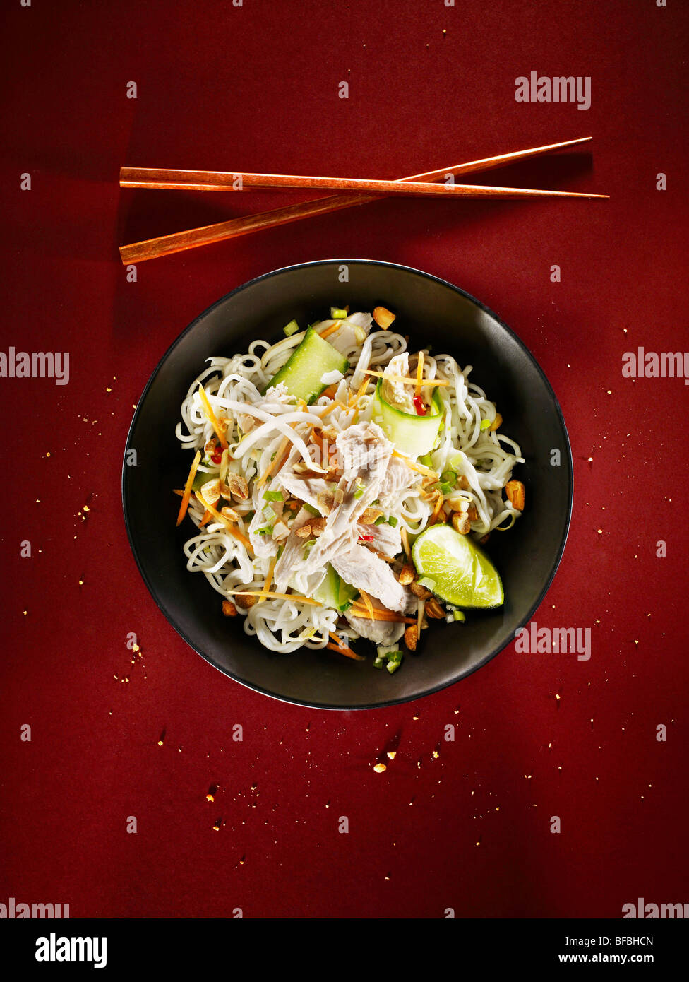 Spicy chicken noodles, an Asian style dish - Stock Image
