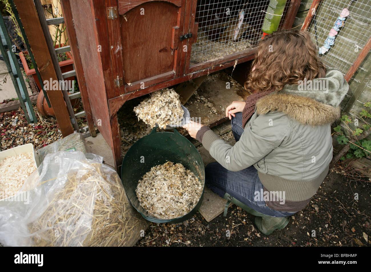 Women Cleaning Rabbit Hutch Garden Stock Photo 26685590