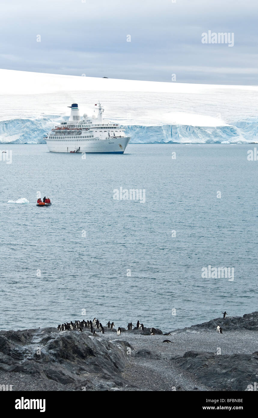 Hope Bay Antarctica cruise ship Discovery holding station and tourists going ashore in a Zodiac rib - Stock Image
