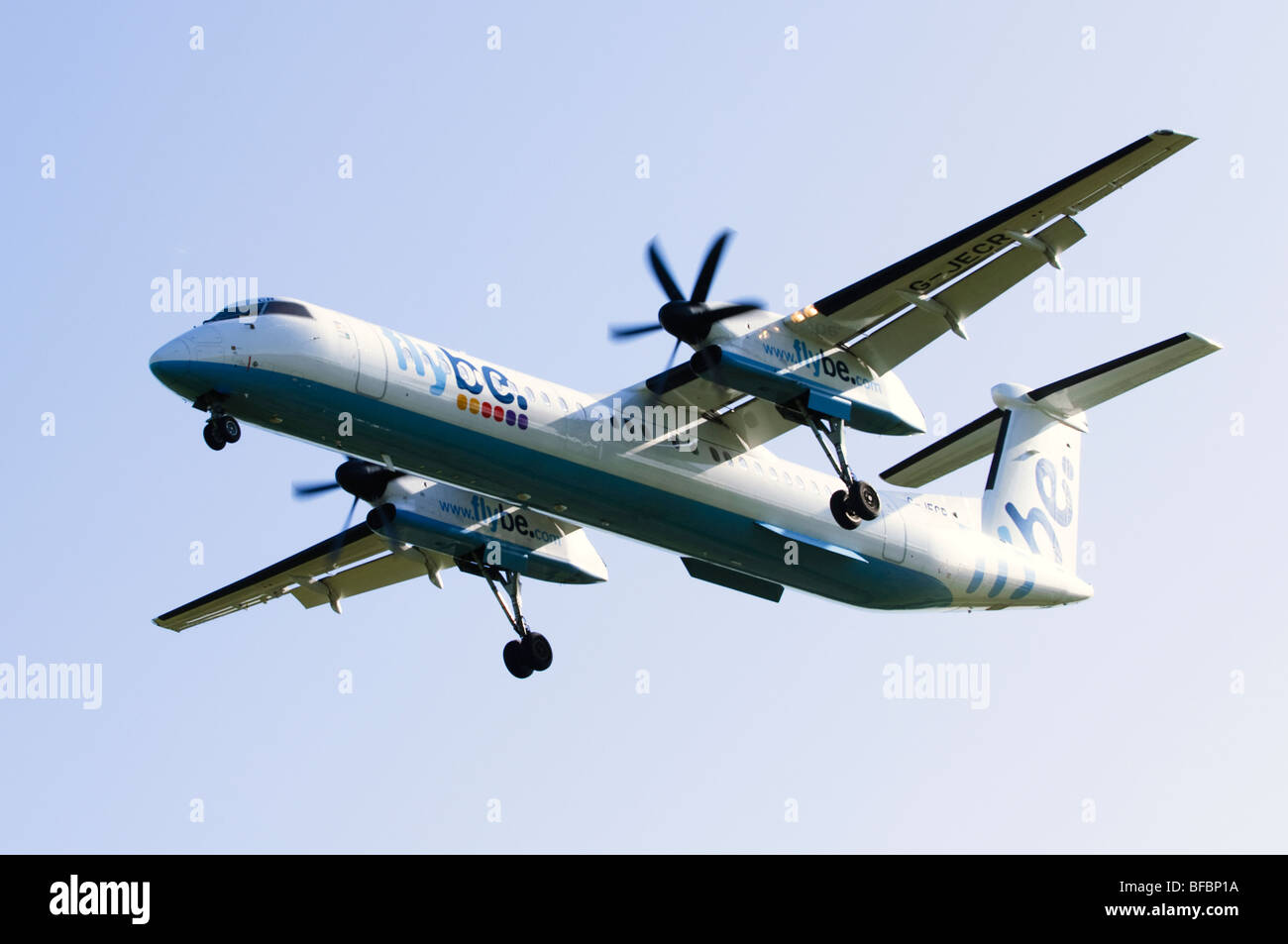 Bombardier Dash 8 operated by Flybe on approach for landing at Birmingham Airport - Stock Image