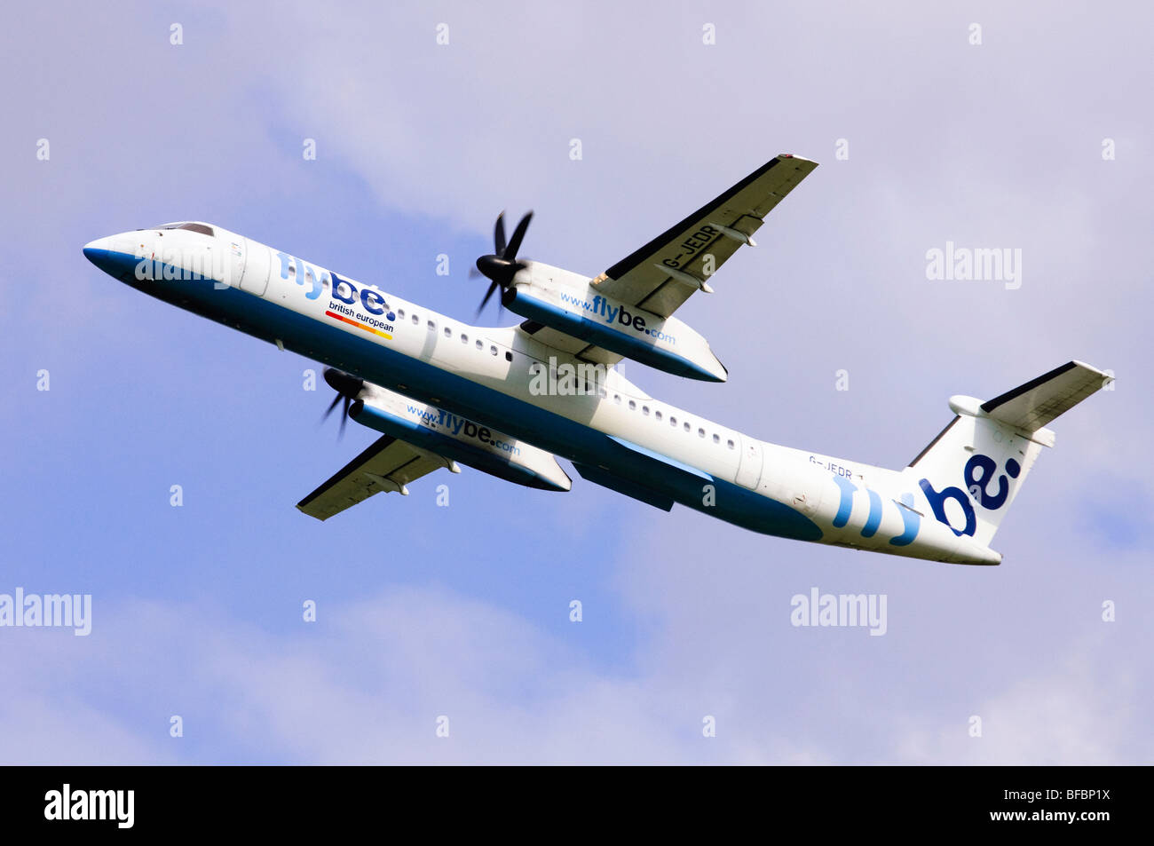 Bombardier Dash 8 operated by Flybe on climbing out from take off at Birmingham Airport - Stock Image