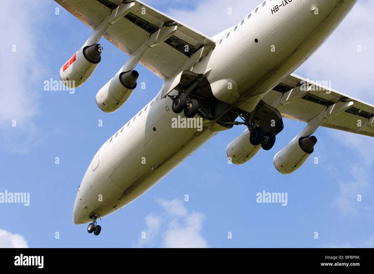 Avro RJ100 operated by Swiss International Air Lines on approach for landing at Birmingham Airport - Stock Image