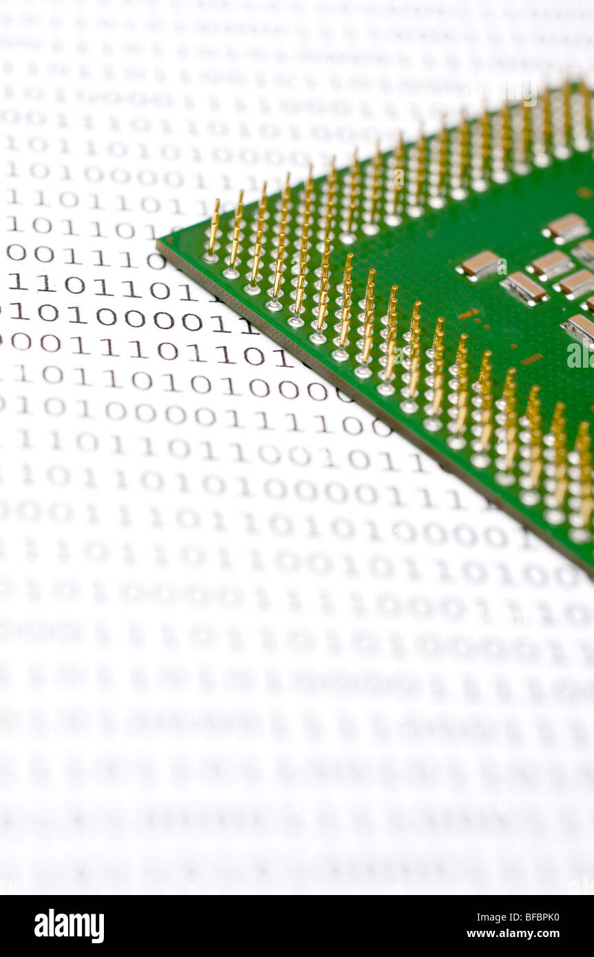 Computer CPU chip on binary code Stock Photo