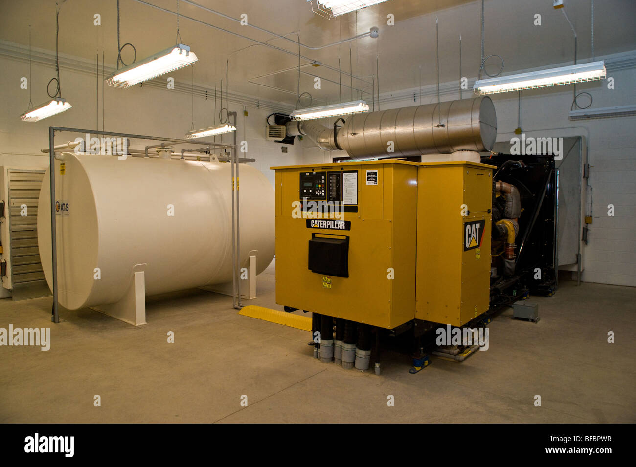 A backup power generator and fuel tank Stock Photo: 26689651