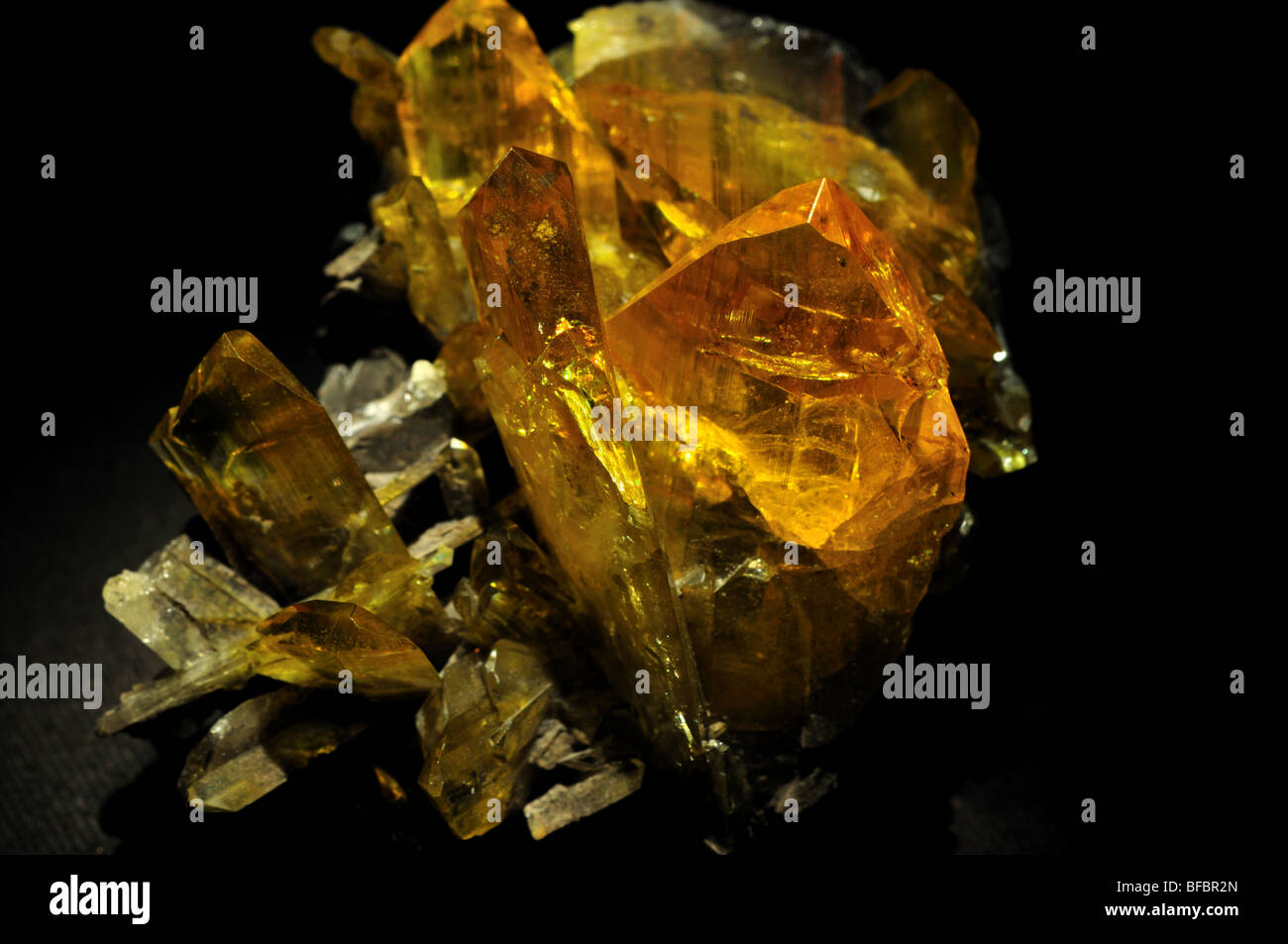Yellow crystals of Anglesite, a lead sulfate mineral PbSO4. - Stock Image