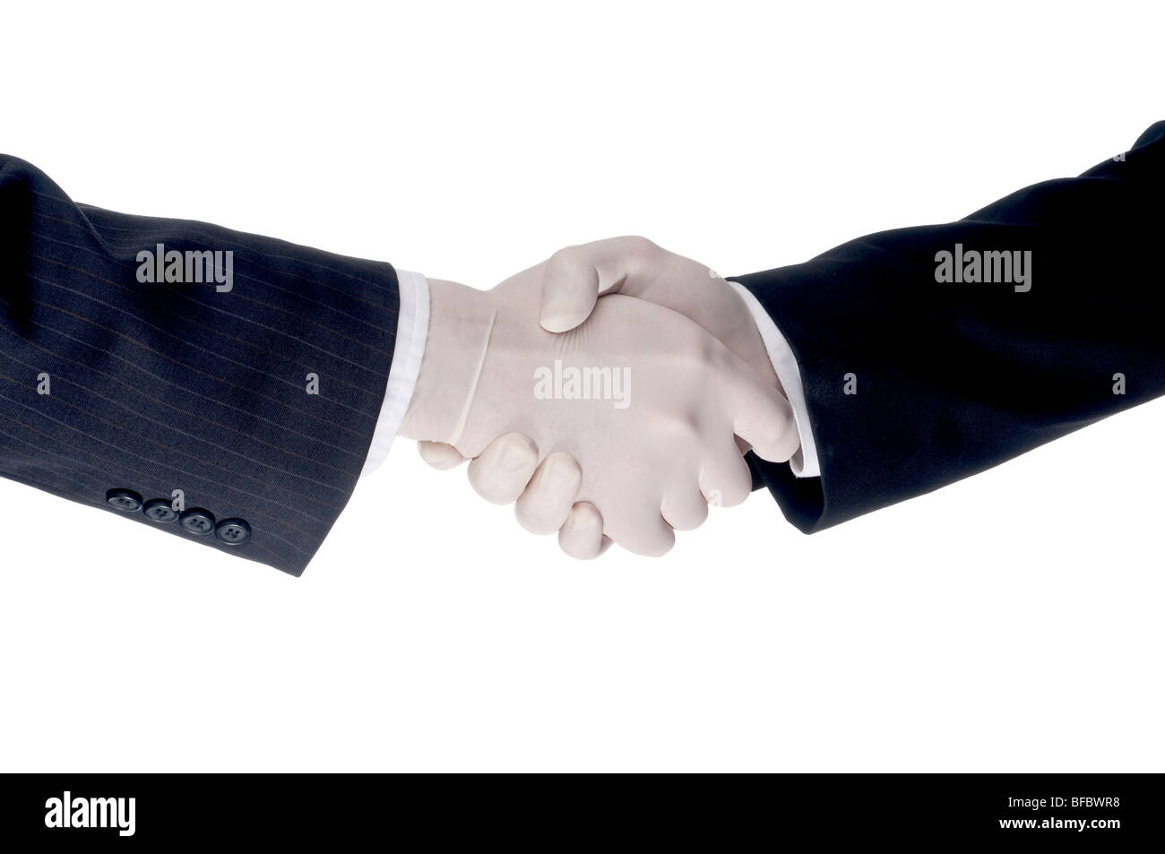 Business men shaking hands wearing gloves to protect against flu virus - Stock Image