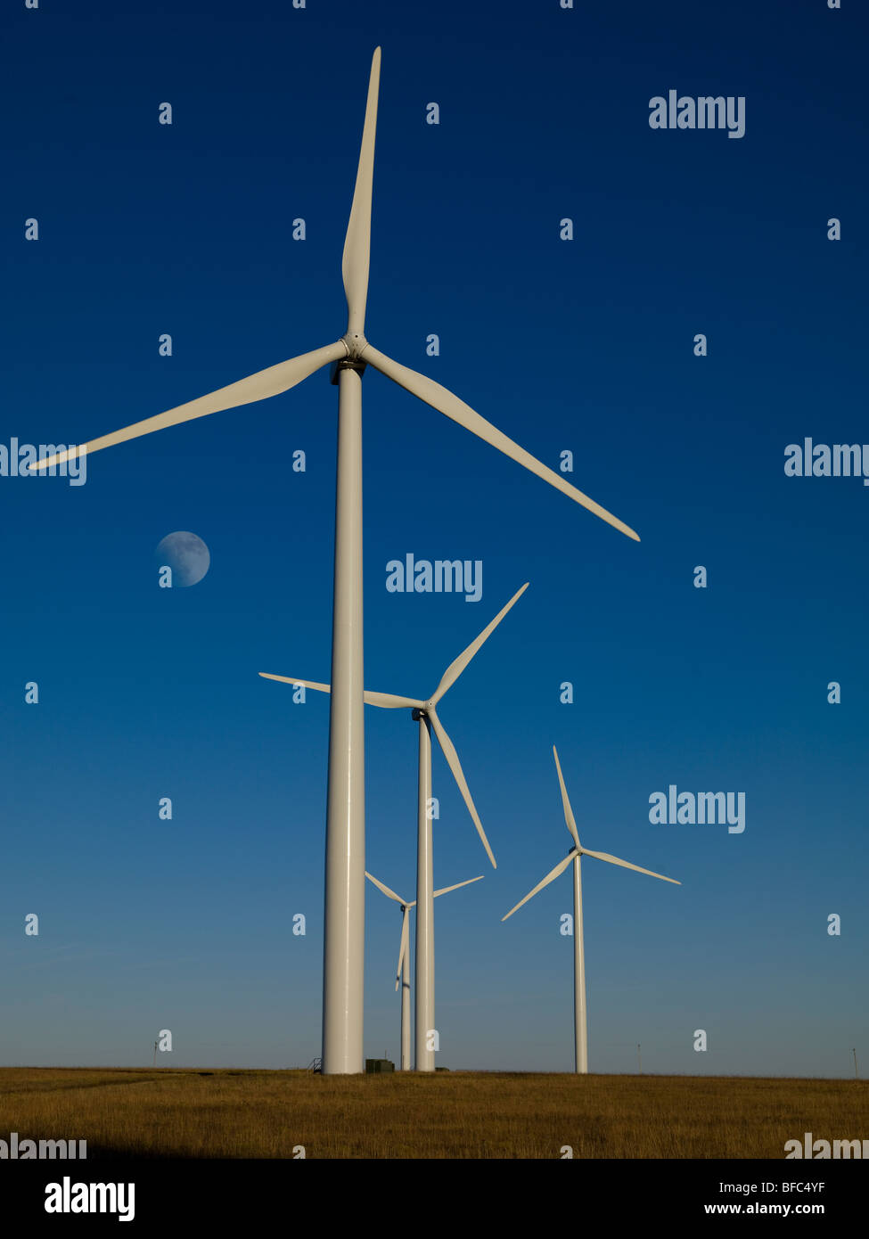 Wind Farm in the Flint Hills near Beaumont, Kansas, USA, afternoon toward the East with moon rising. - Stock Image