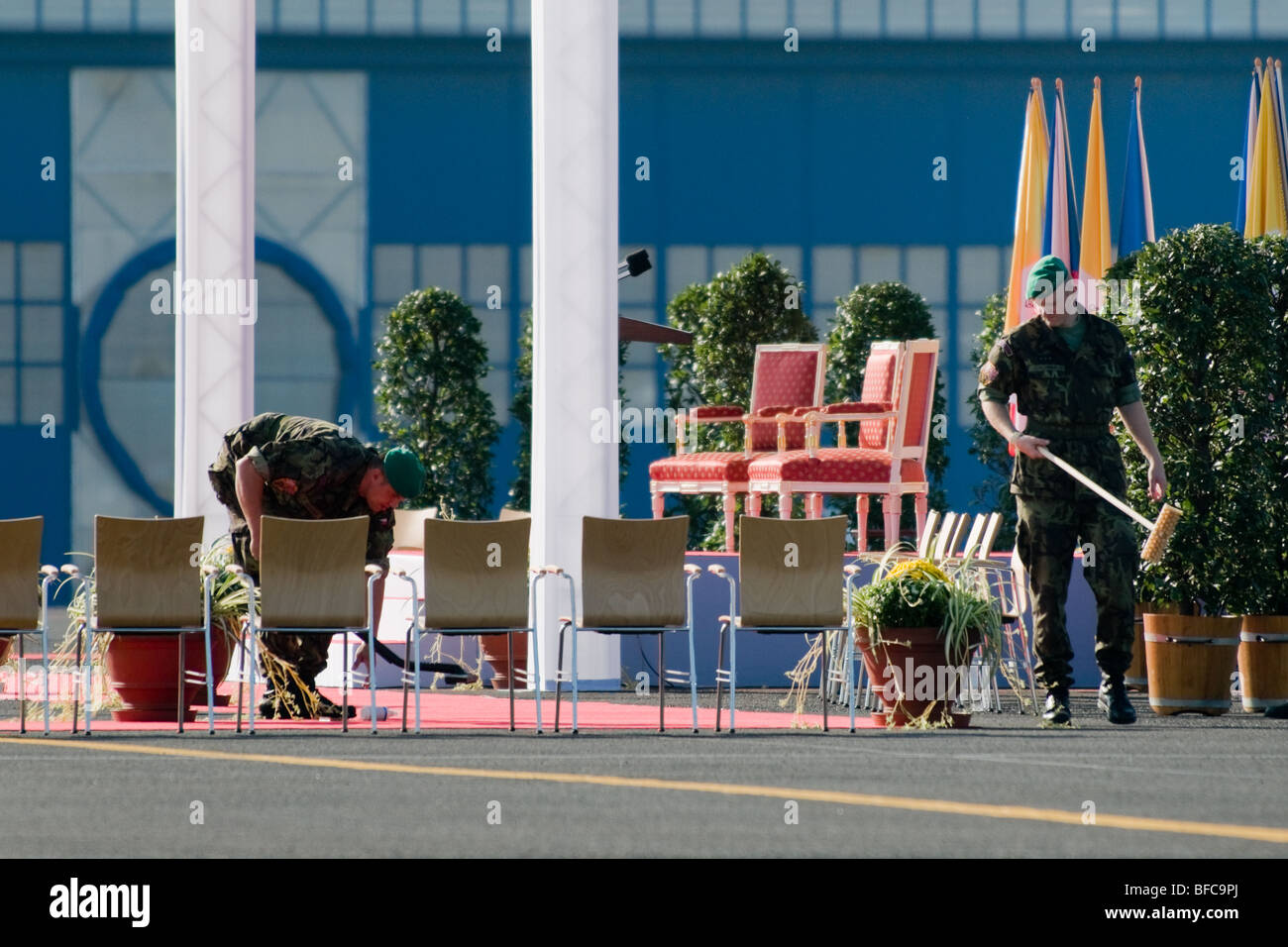 Czech soldiers cleaning the red carpet right before the arrival of the Pope Benedict XVI at the Prague Airport, - Stock Image