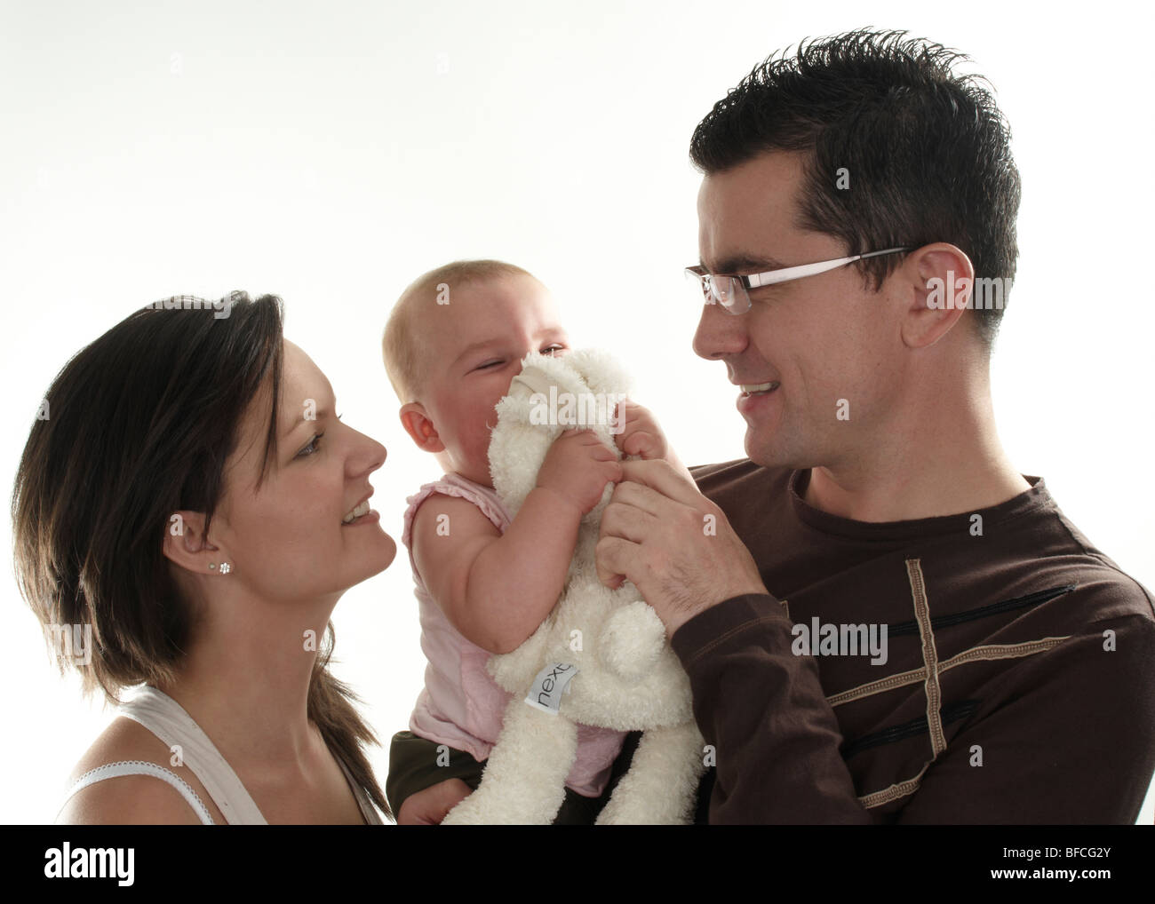 family portrait of mum, dad and baby girl Stock Photo