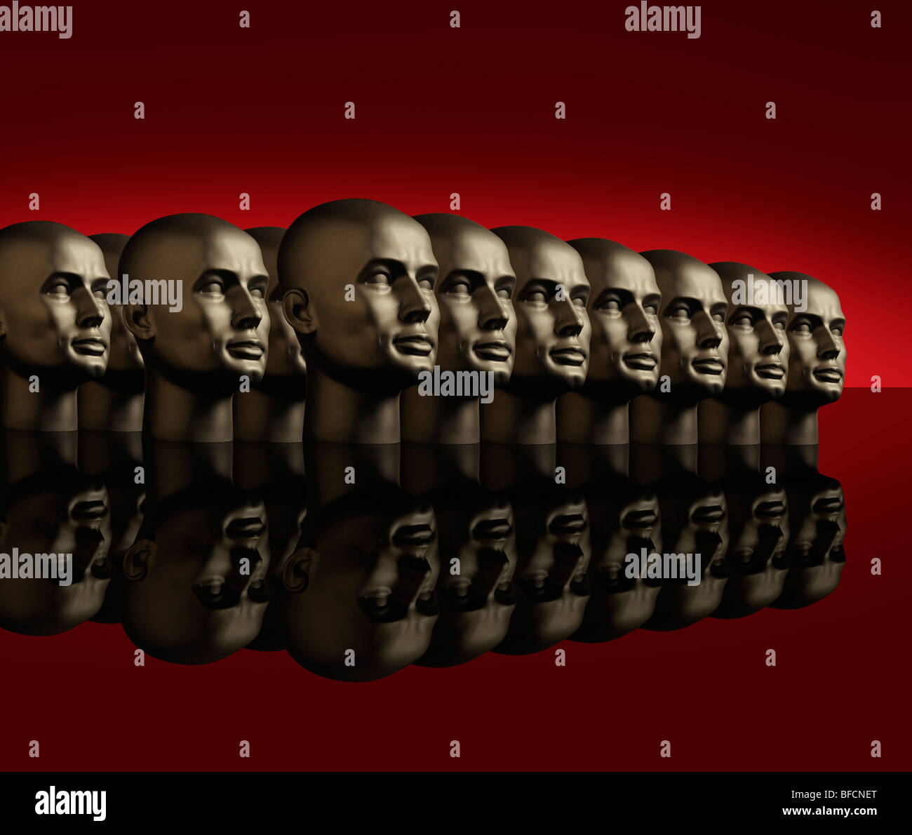 Metallic android mannequin heads lined up in several rows on a reflective black surface with a red background - Stock Image