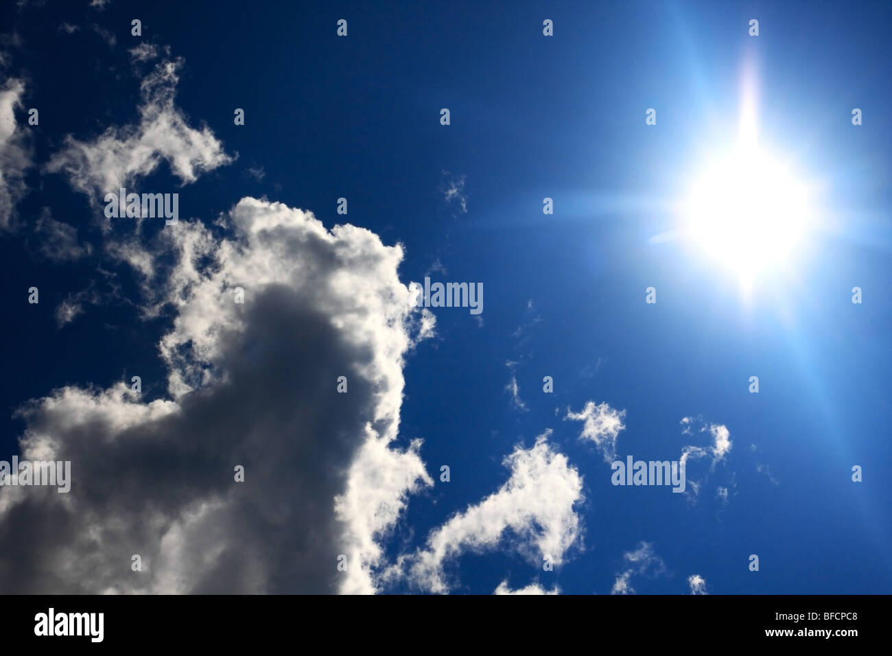Blu sky, cloud and sun. Nobody. - Stock Image