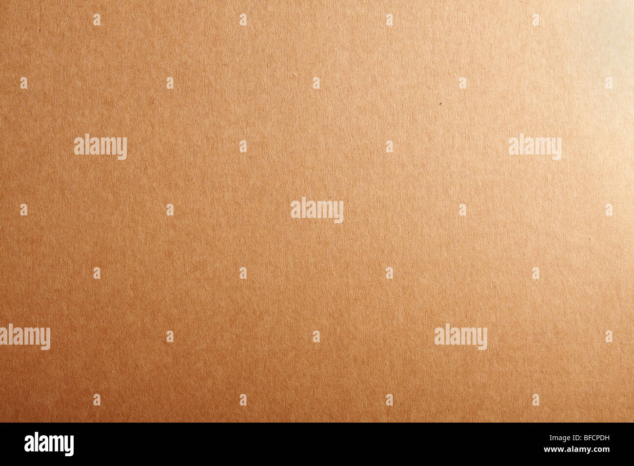 Blank beige cardboard textured background. - Stock Image