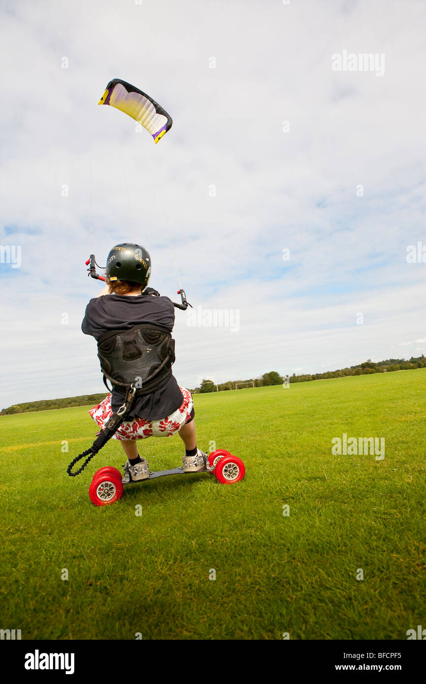 Extreme sport, freestyle kite landboarding, flying inland in open field Stock Photo