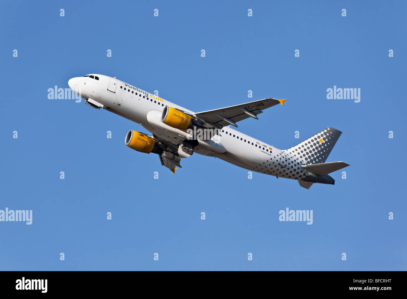 An Airbus A320 of the Spanish airline Vueling airlines on take off - Stock Image
