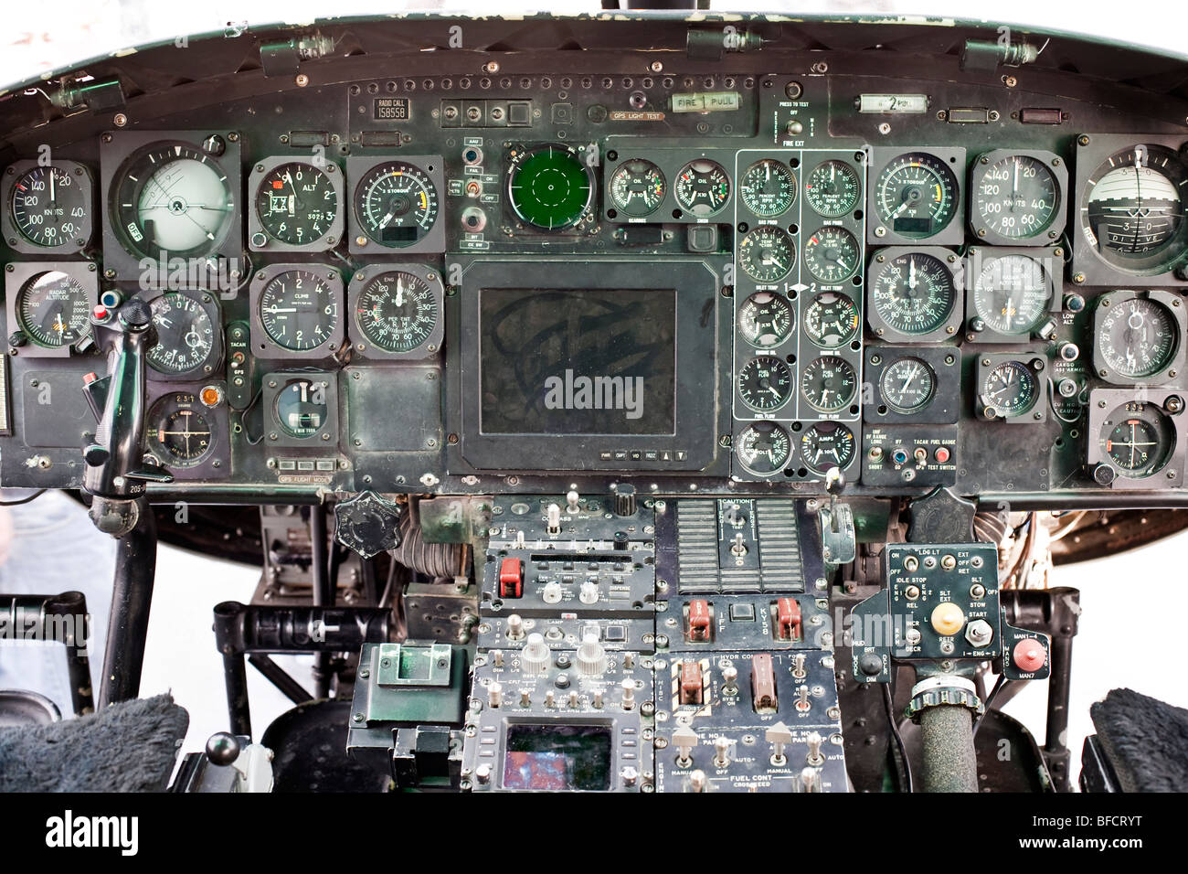 worn instrument panel in cockpit of US Marine Corps Huey helicopter displayed on flight deck of USS New York moored - Stock Image