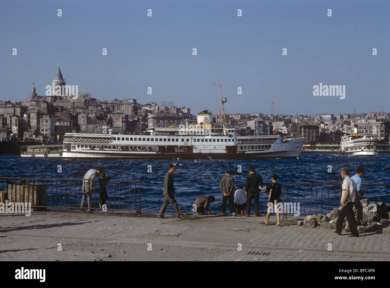 Ferry boats, the Galata Tower across the Golden Horn from the Eminönü waterfront, İstanbul, Turkey  670924 - Stock Image